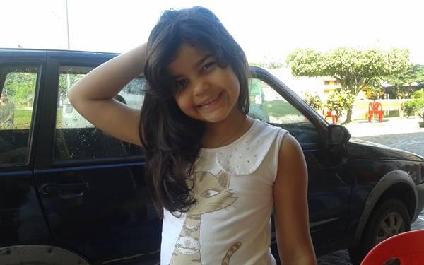 Ana Luísa com seu sorriso inocente