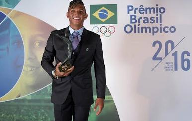 Primeiro brasileiro a conquistar três medalhas em uma mesma Olímpiadas